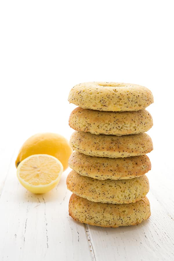 stack of 6 keto lemon poppyseed donuts with lemon in the background
