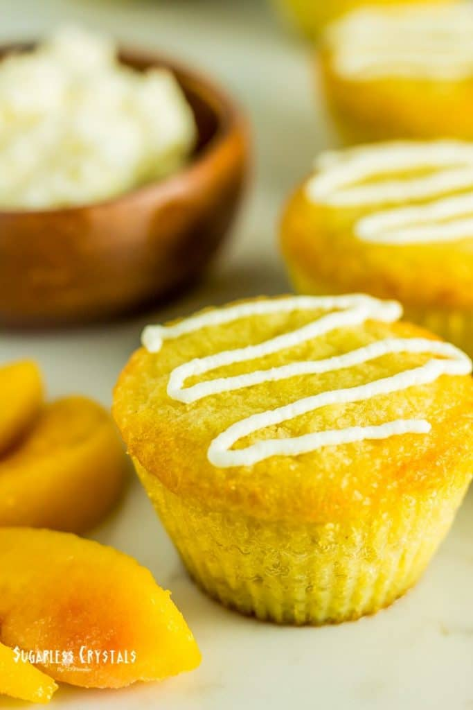 keto lemon coconut flour cupcake with icing drizzled on top