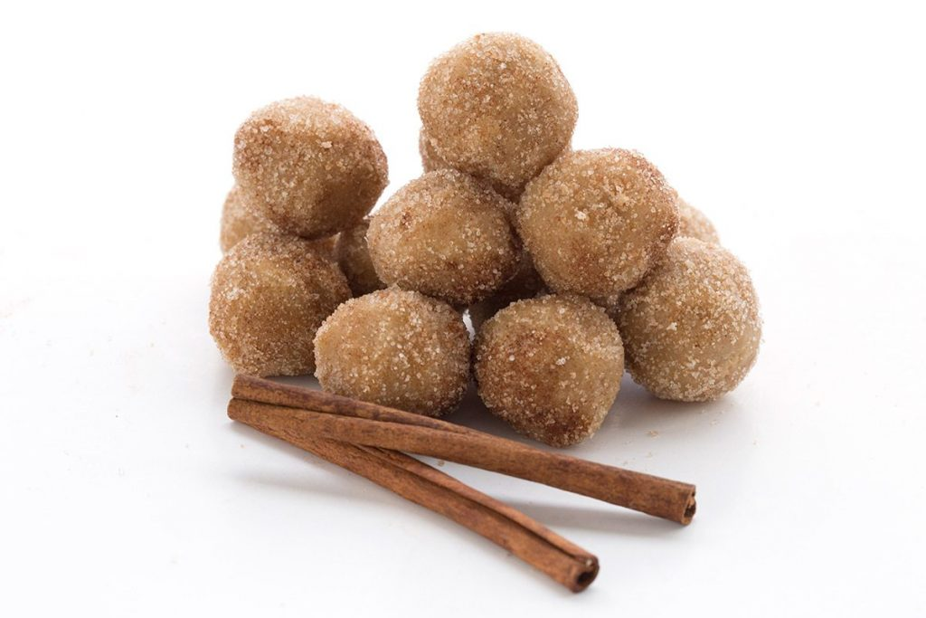 pile of snickerdoodle truffles with cinnamon sticks