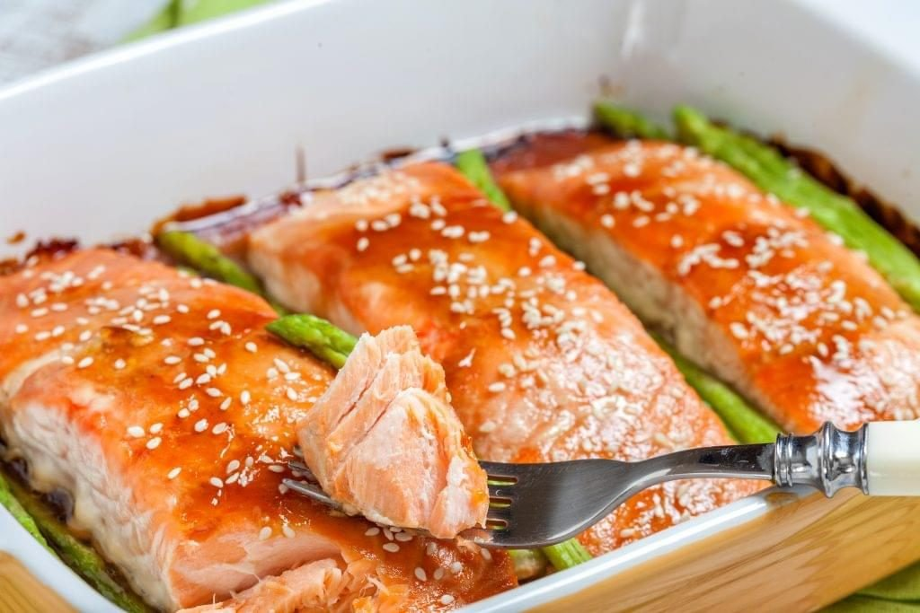 teriyaki salmon with asparagus in a dish
