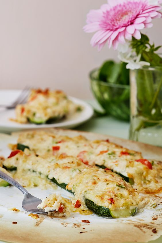 keto crab melt in zucchini boats with a flower aside