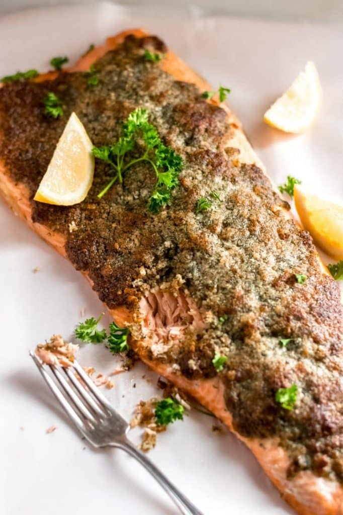 Crispy Parmesan Dill Salmon topped with lemon slices and parsley