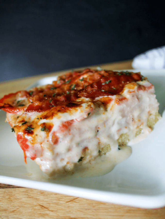 slice of kentucky hot brown casserole with cream oozing out the side