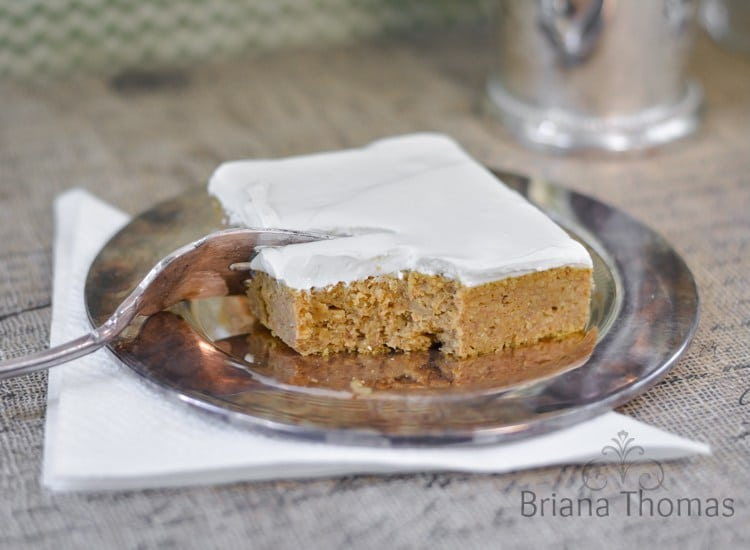 pumpkin bar on a silver plate being cut with a fork