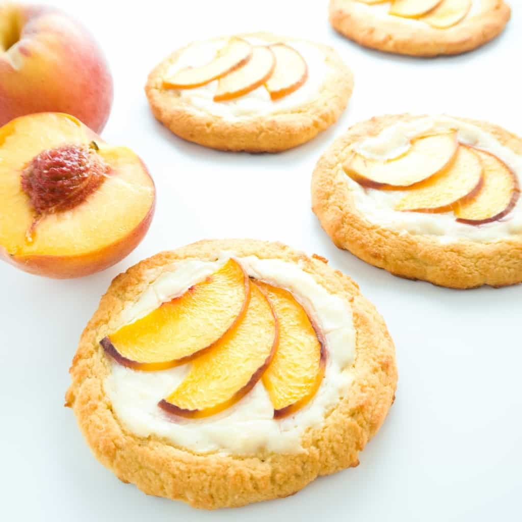 low carb cheese danish with peaches aside a fresh sliced peach