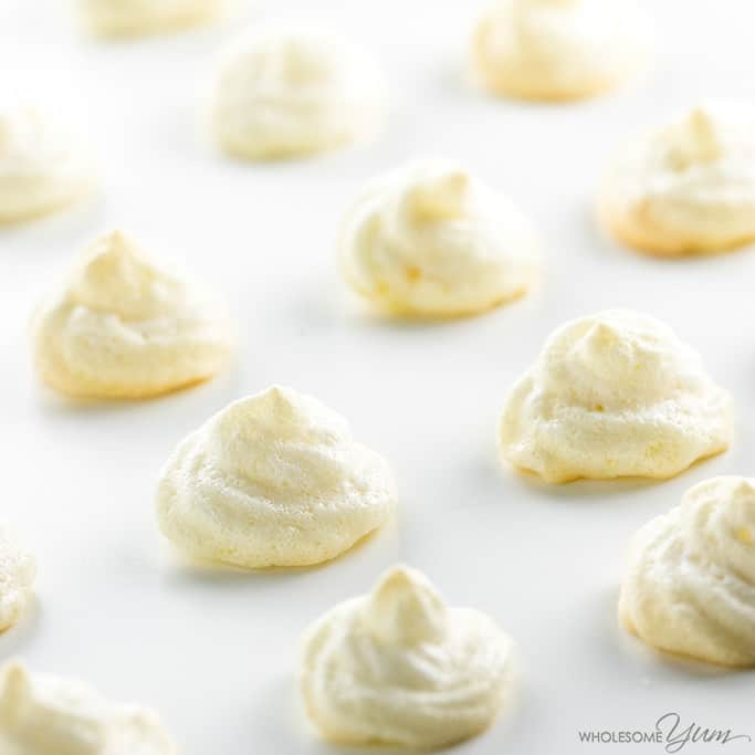 easy sugar-free lemon meringue cookies lined up on a white surface