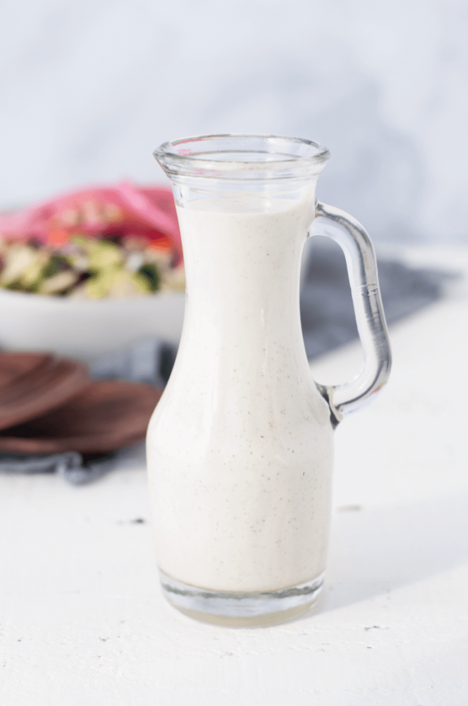 keto honey mustard dressing in a glass pouring container