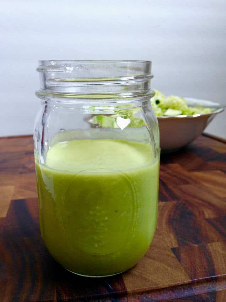 creamy dill pickle dressing in a mason jar