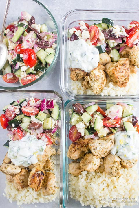 4 low-carb greek chicken bowls in glass meal prep containers