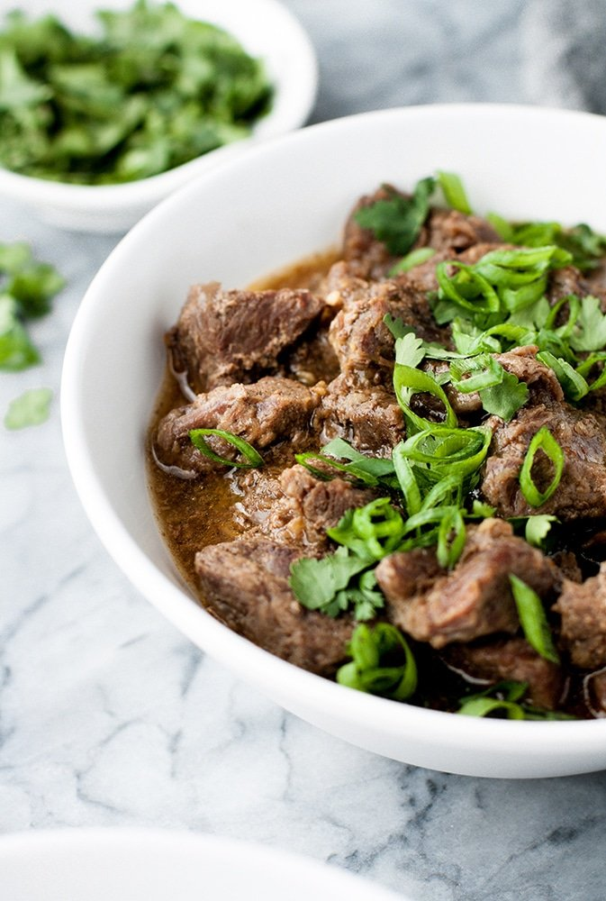 hero shot of Keto Korean Barbecue Beef Freezer Meal atop a marble kitchen counter