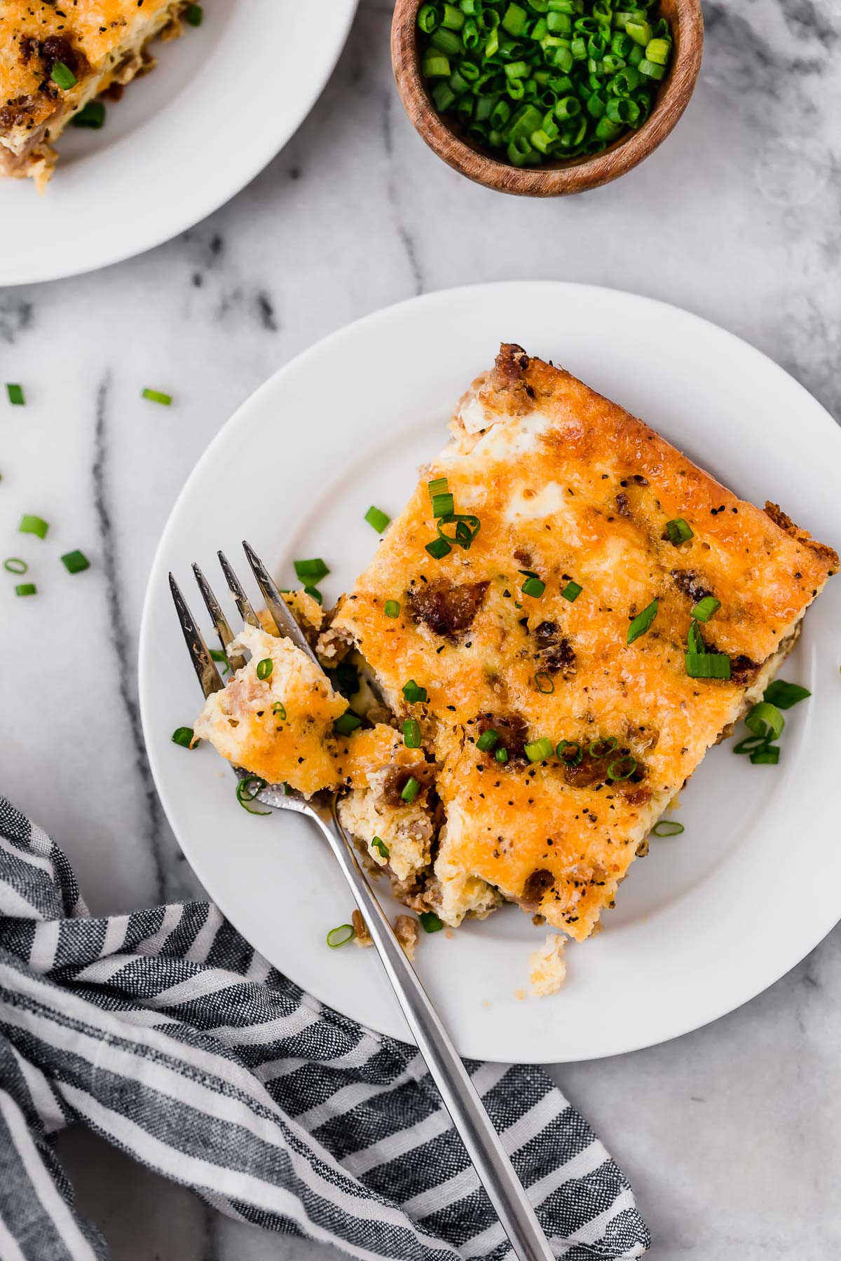 Baked Low Carb Sausage Breakfast Casserole on a plate eaten with a fork