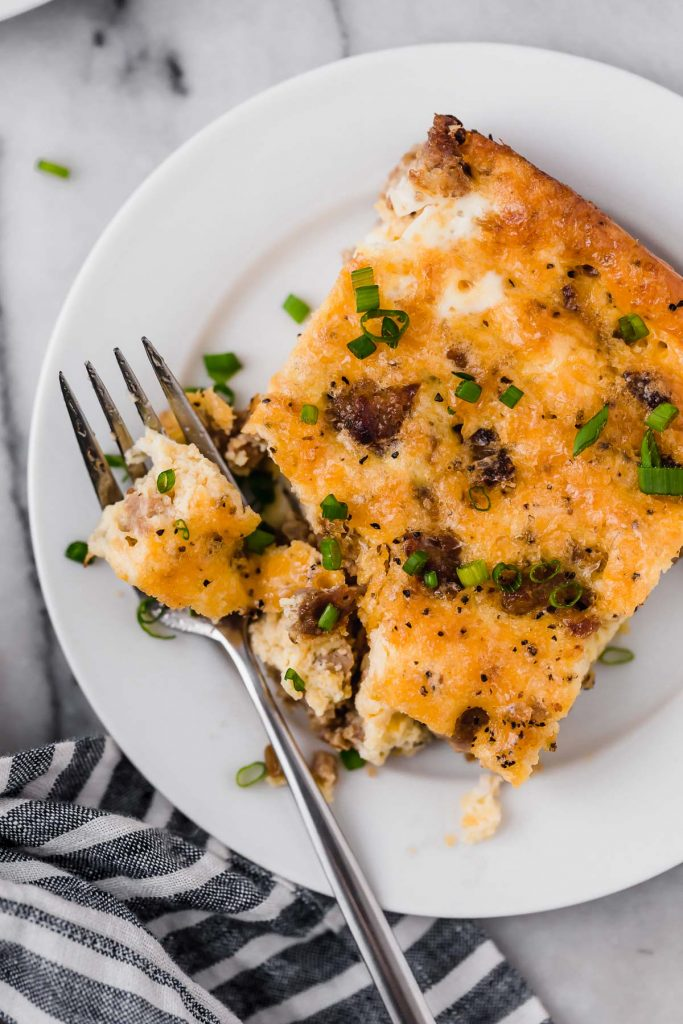 overhead shot of Low Carb Sausage Breakfast Casserole serving on a plate with a fork