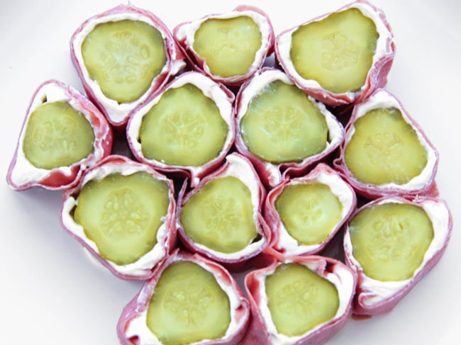 top view of pickle roll ups on a white surface