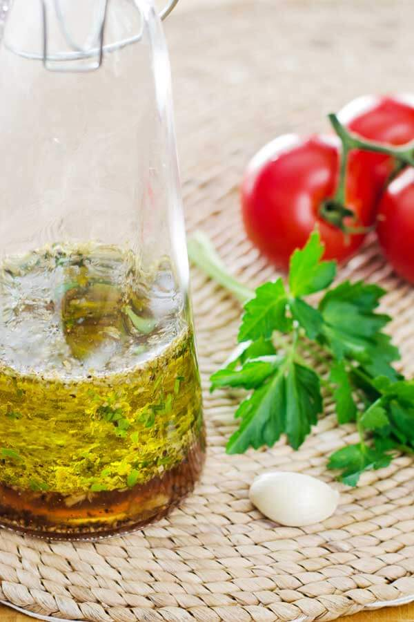 italian dressing with tomatoes, parsley, and garlic aside