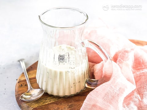 healthy poppy seed salad dressing in a glass pouring container