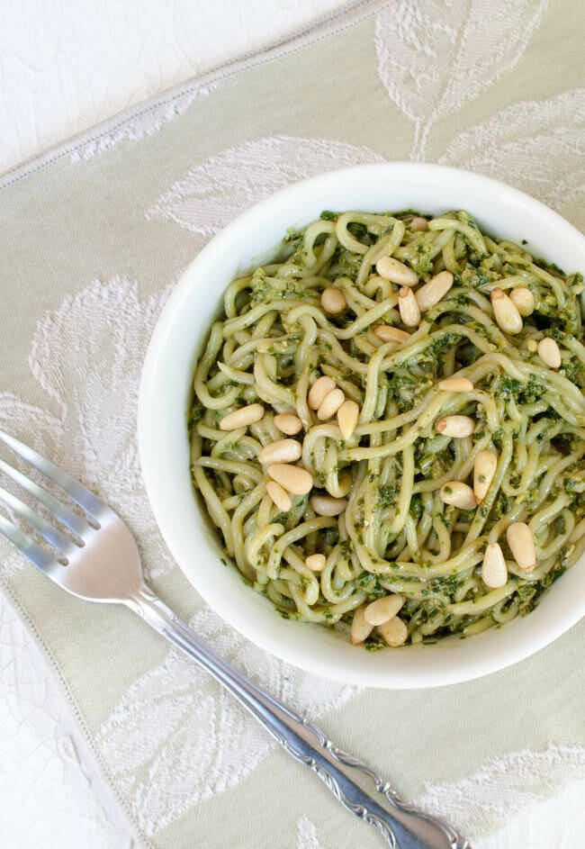 vegan pesto shirataki noodles with pine nuts on top