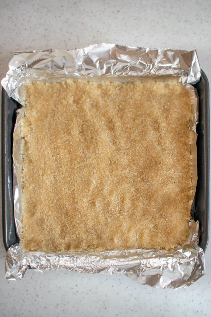 coconut mixture pressed into an 8x8-inch baking pan lined with foil