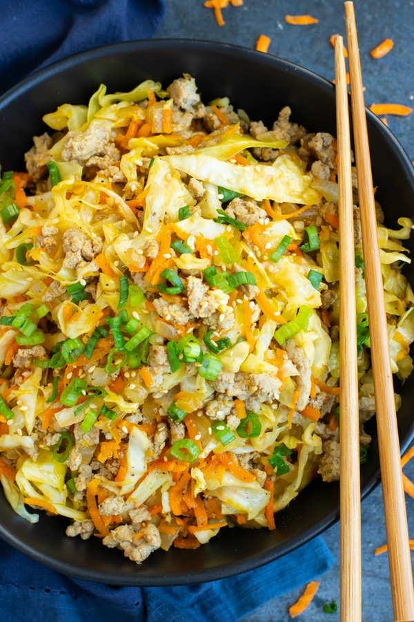 egg roll in a bowl with chopsticks on the side