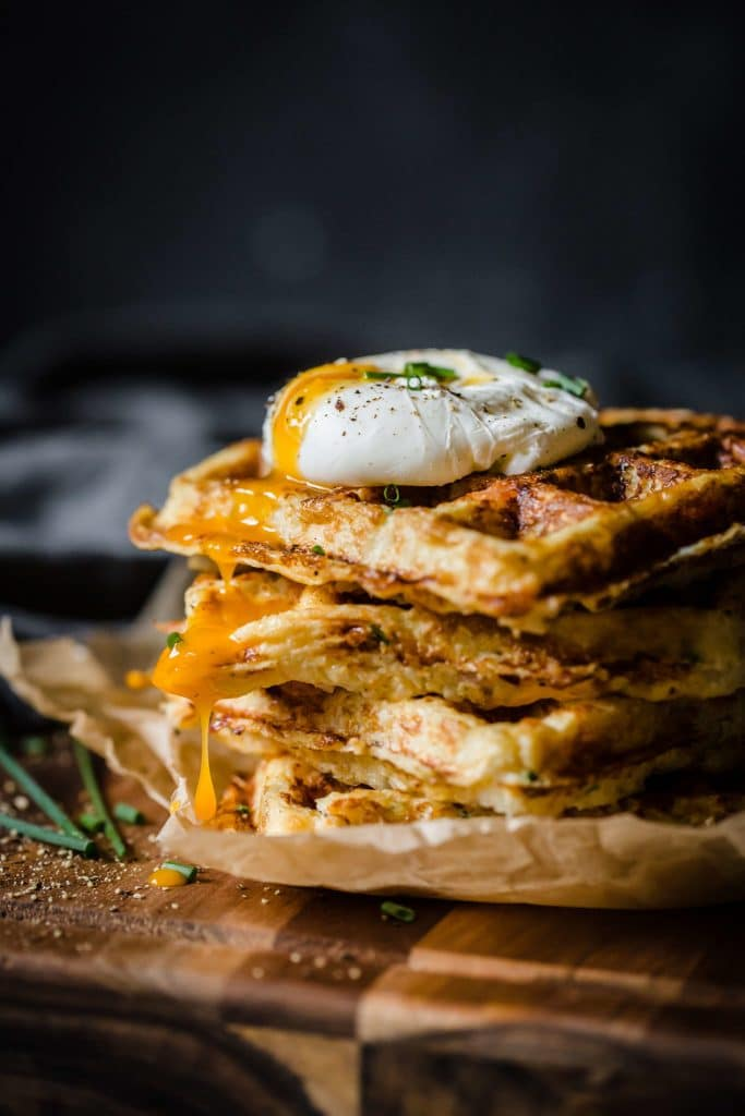 Stack of Ham and Gruyere Cauliflower rice waffles with a poached egg on top