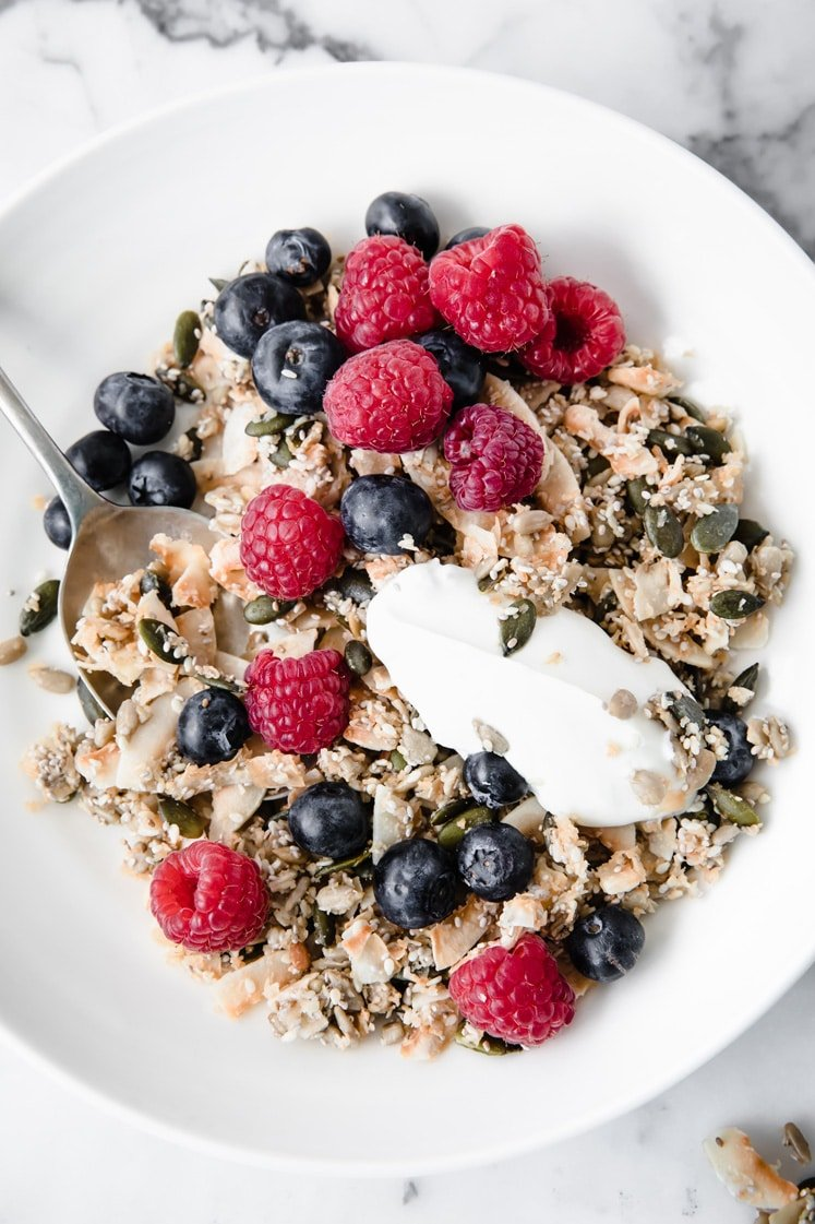 featured recipe image Nut Free Keto Cereal in a bowl with raspberries and blueberries
