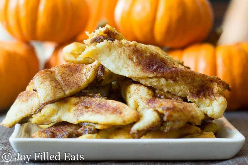 Keto Pumpkin Pie Twists piled on a square plate