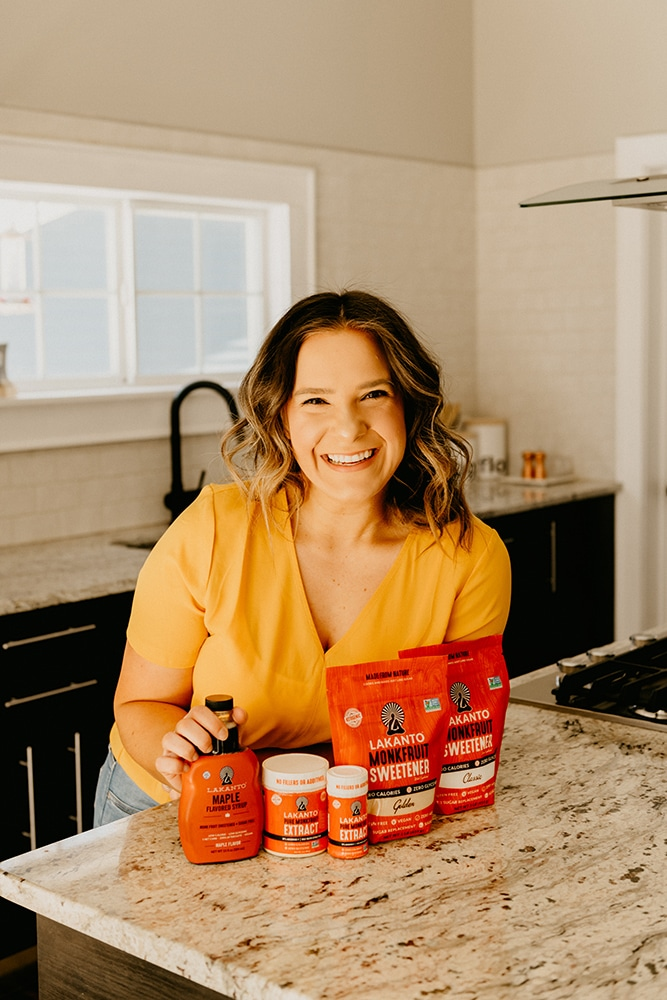 sara nelson of real balanced posing in kitchen with Lakanto monk fruit sweetener products