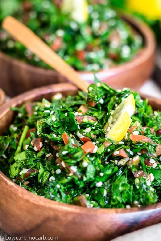 close up shot of tabbouleh salad in a wooden bowl