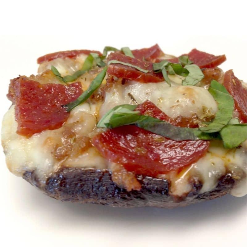 close-up shot of Portobello Mushroom Mini Pizza atop a marble kitchen counter