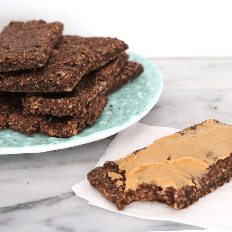 chocolate vegan protein bars on a plate atop a marble kitchen counter