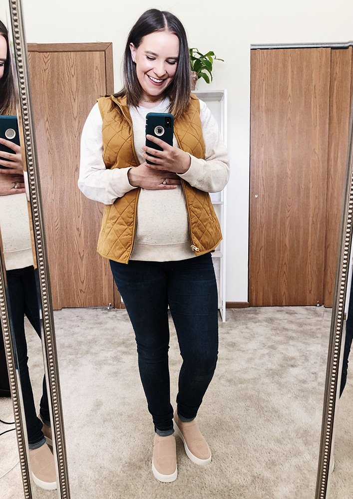 Sara Nelson of Real Balanced in old navy crewneck sweatshirt, maternity jeans, and steve madden slip-on shoes
