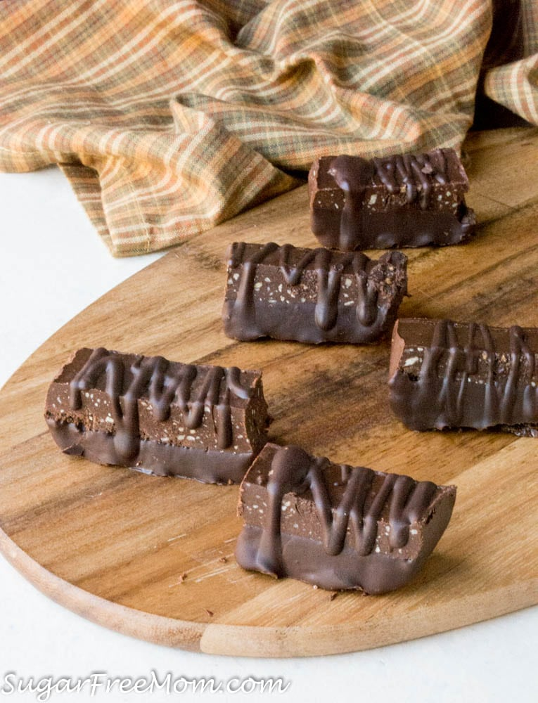 5 low carb chocolate fudge protein bars on a wooden tray