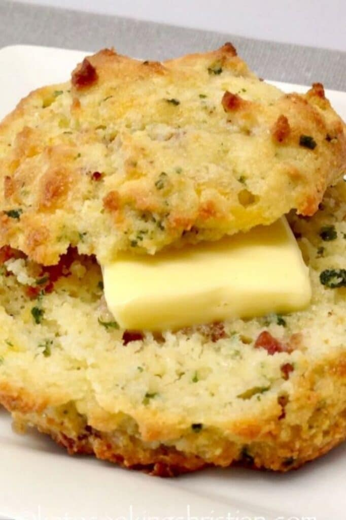 bacon cheddar drop biscuit slice in half on a plate