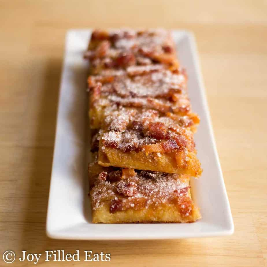 a plate of maple bacon crack atop a wooden table