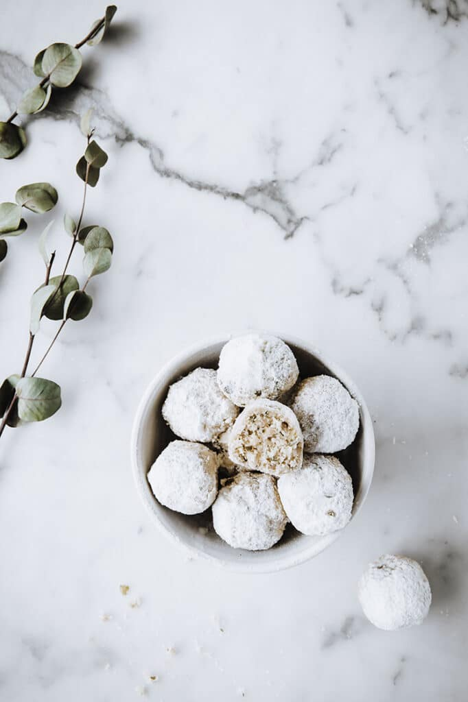 featured image of nut-free keto snowball cookies on a small bowl atop a marble kitchen counter