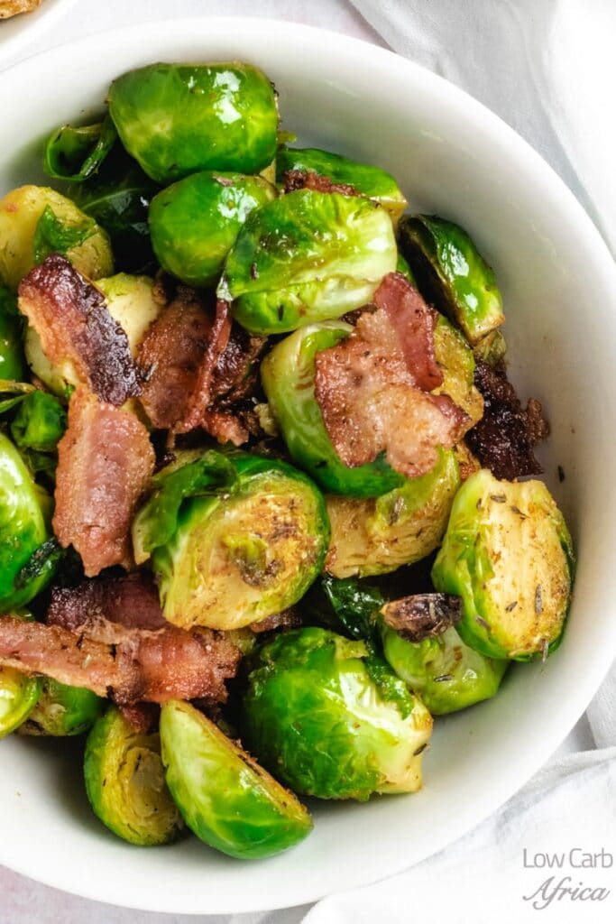 stir-fried brussel sprouts with a bacon in a bowl