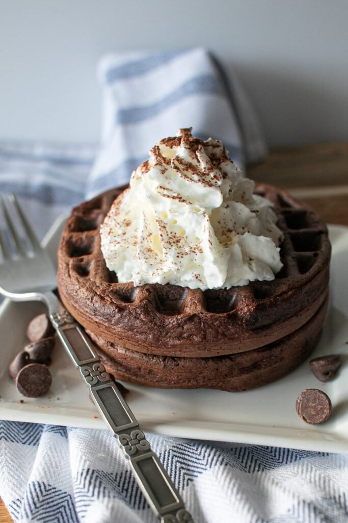 an image of chocolate brownie chaffle served on a square shaped plate