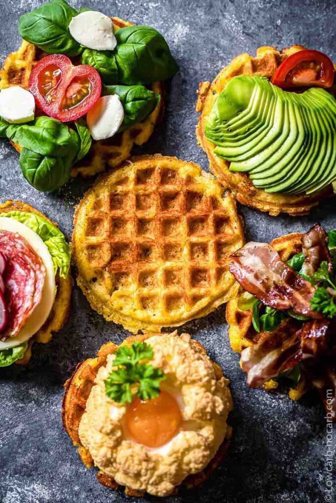 overhead caption of 6 yogurt keto chaffles topped with different fruits