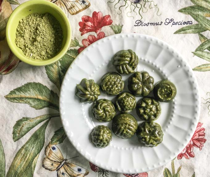 low carb mint matcha coconut candy on a plate atop a table