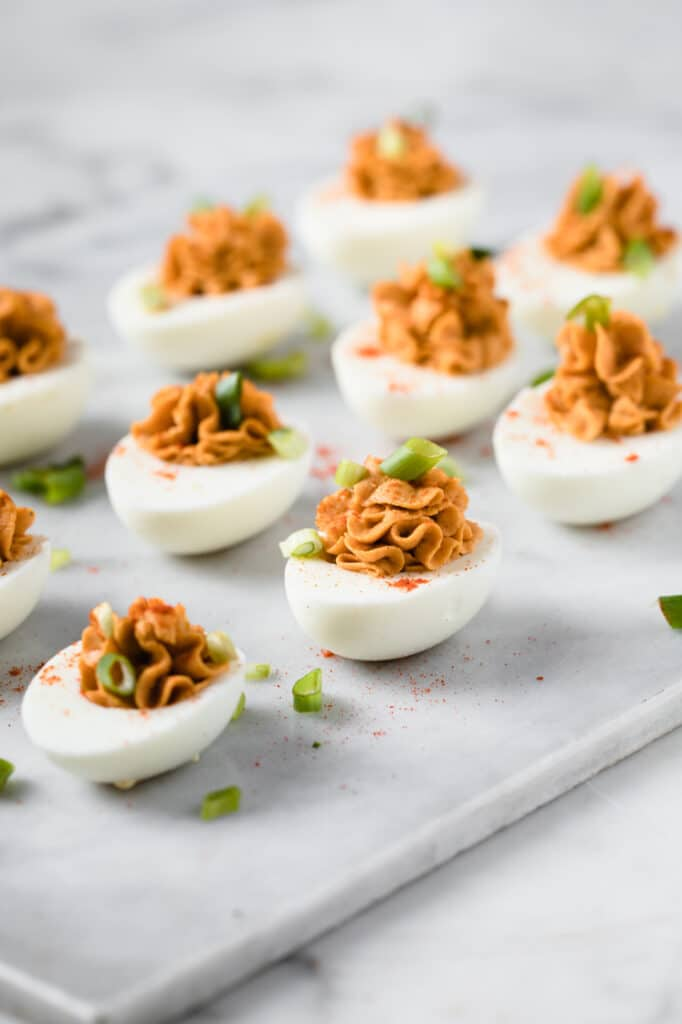 hero shot keto buffalo deviled eggs with chopped green onion