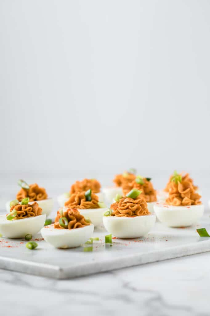 side angle shot keto buffalo deviled eggs on a marble board