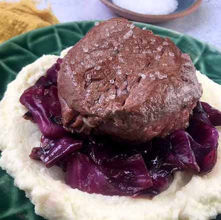 keto steak recipes - a plate of Filet Mignon with Braised Red Cabbage