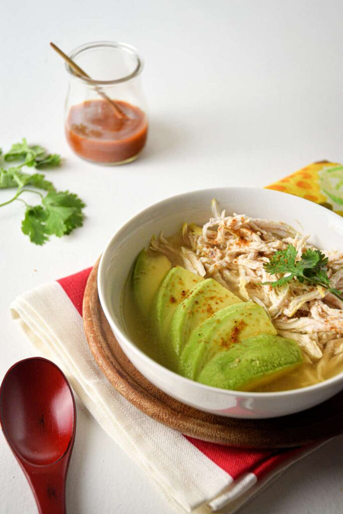 Keto Mexican-Inspired Recipes - a bowl of Avocado Chicken Posole