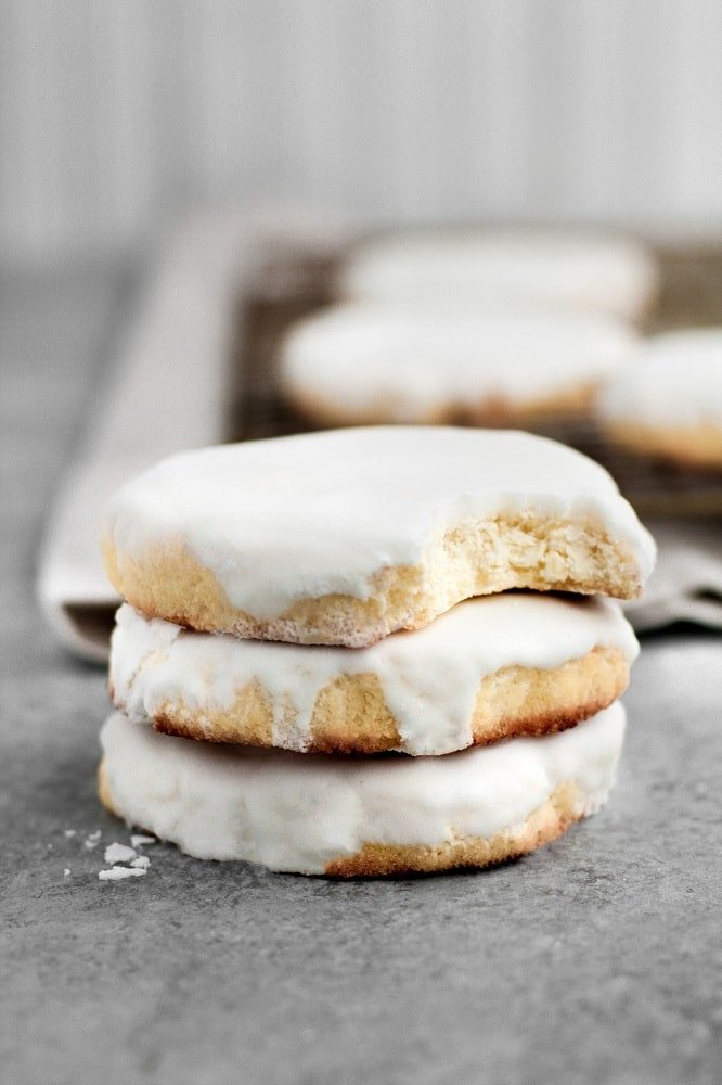 Low-Carb Glazed Sugar Cookies stacked on top of each other