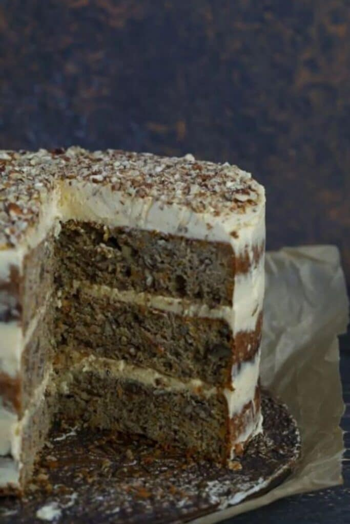 close-up shot of Keto Carrot Cake with Cinnamon Buttercream atop a wooden table