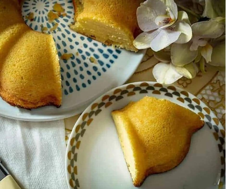 overhead image of Keto Lemon Pound Cake on a plate atop a wooden table