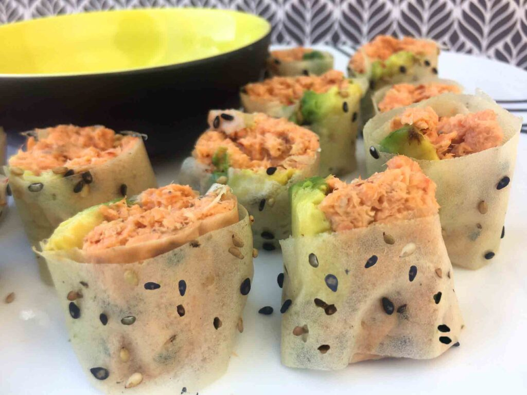 spicy salmon sushi roll on a plate