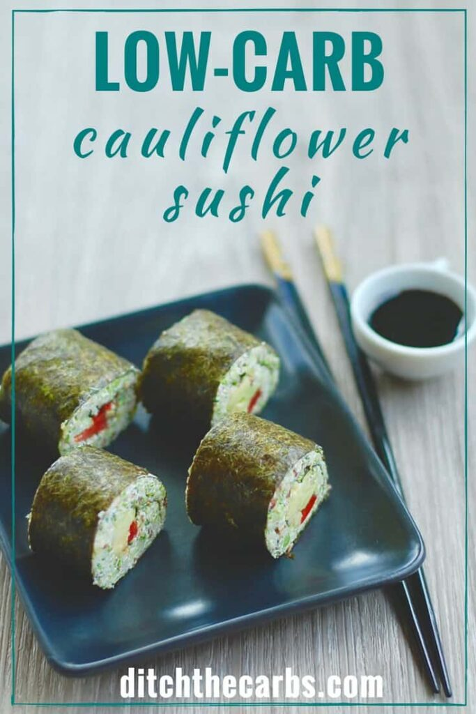 4 cauliflower sushi roll on a plate with a pair of chopsticks at the side