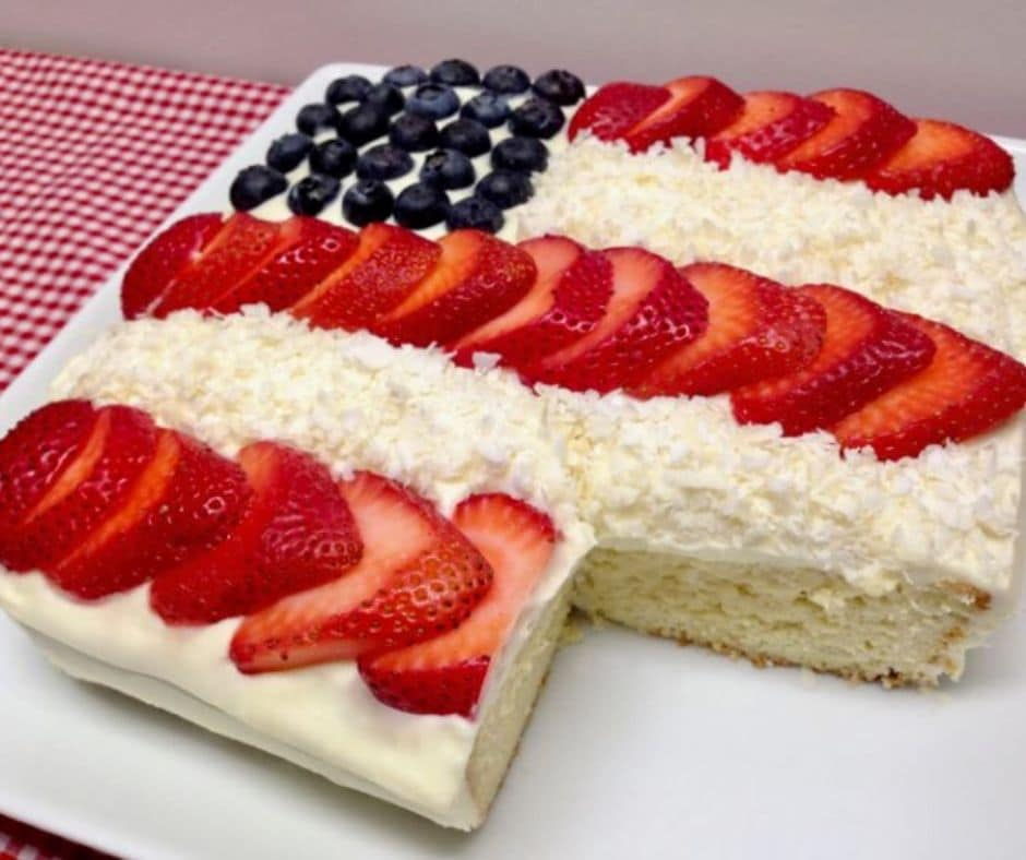 American Flag cake with a slice taken out of it's lower right corner