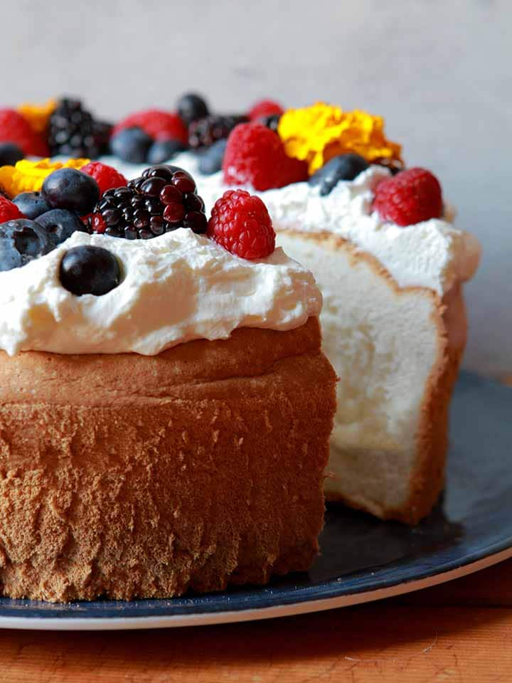 keto berry recipes: a close-up image of an Angel Food Cake on a plate with a slice taken out