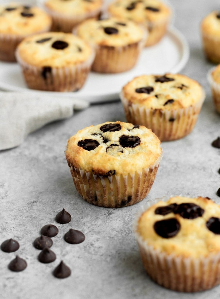 yummy low carb chocolate chip banana bread muffins beside chocolate chips
